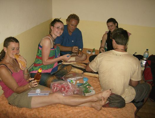 Savannah having a family travel dinner in Guinea Bissau, West Africa