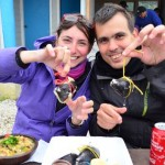 Rachele and Gabor from Surfing the Planet eating sea food in Chiloe