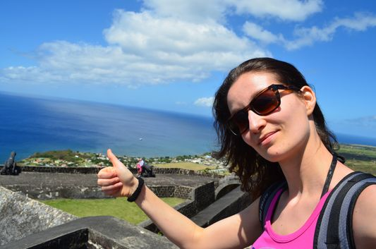 crazy sexy fun traveler on top of Brimstone Hill Fortress St. Kitts